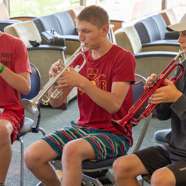 Young male trumpet players