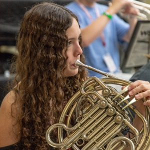 Female French Horn player